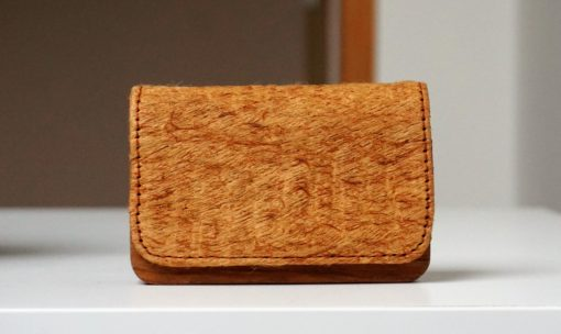 wooden card holder on white table