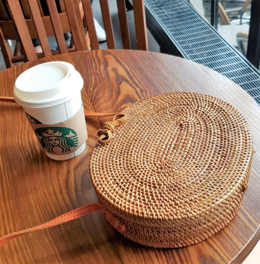 ovale atta on table with starbucks cup