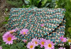 turquoise woven clutch in flowers