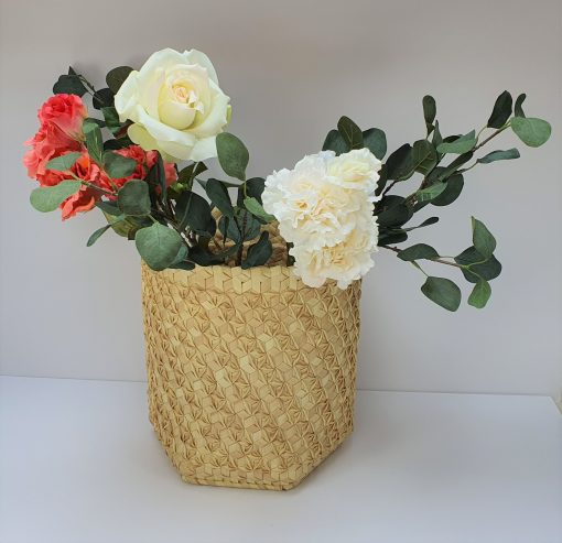 natural basket with flowers inside