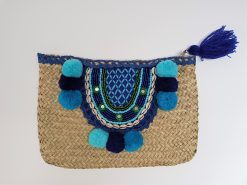 beach bag with blue pom pom woven